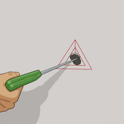 Skär ut triangeln i gipsväggen med en vass kniv