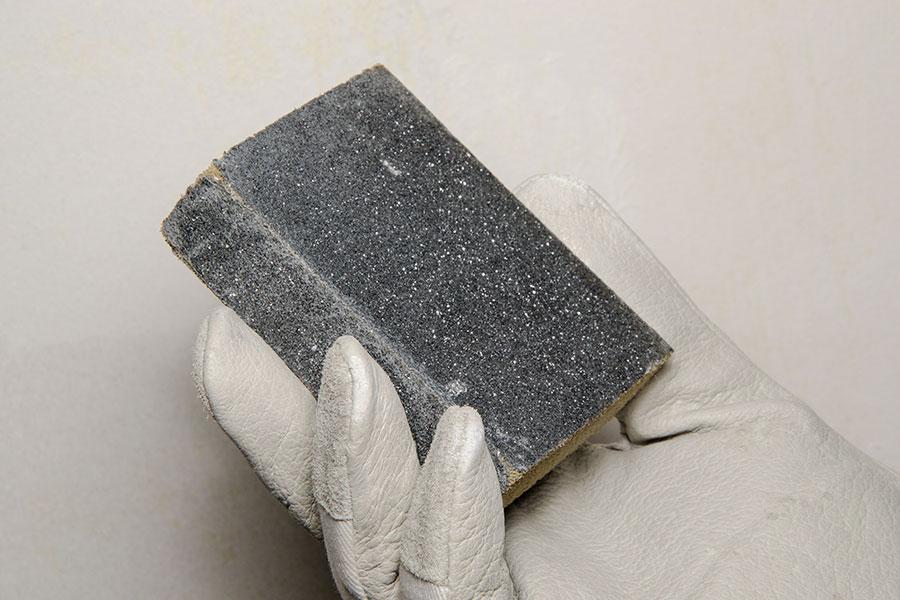 Slipsvamp för att matta ner en blank yta för hand