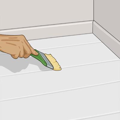 Stryk ut färgen på en begränsad yta över ett par plank i taget
