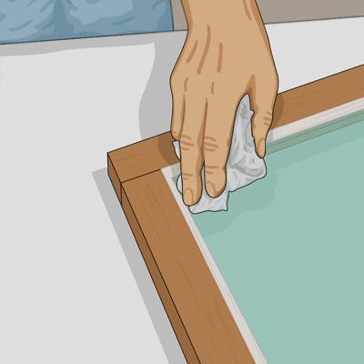Torka bort kittrester på fönsterbågen med en trasa och lite terpentin