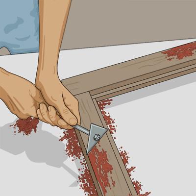 Skrapa bort löst sittande färg på fönsterbågen