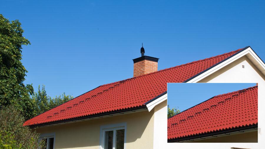 Nylagt tak med röda betongpannor.