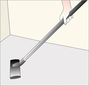 dammsuger rent golvet före läggning av klinkergolv