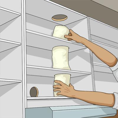Drar ventilationsslang för köksfläkten genom urtag i köksskåpet