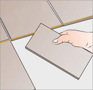 lägger första klinkerraden med riktsnöre