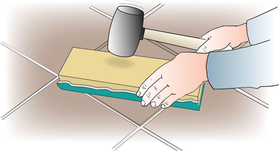 Byt ut en skadad klinker eller kakelplatta. bild 5