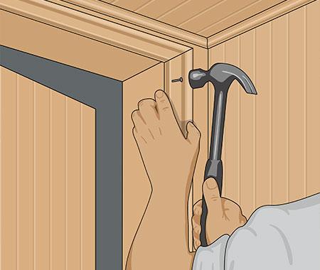 Häng den färdiga bastudörren
