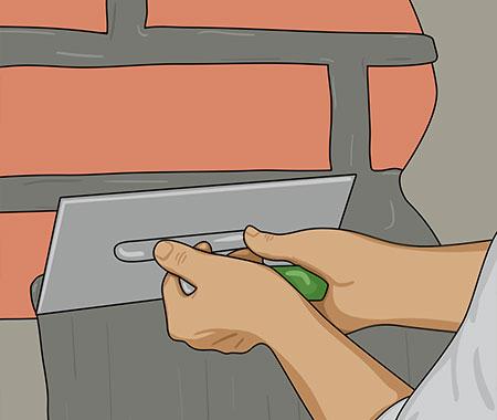 Använda mursleven eller en stålskånska för att slå på bruket