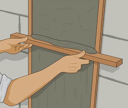 Steg 12. När bruket börjar sätta sig. Dra av överskottet av bruket med rätkäppen.