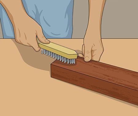 Borsta ytan med stålborste eller maskin