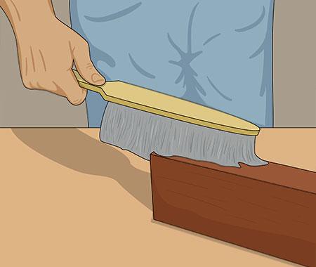 Gör ren ytan från allt slipdamm med en borste