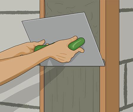 Steg 14. Jämna ut putsytan med stålskånskan.