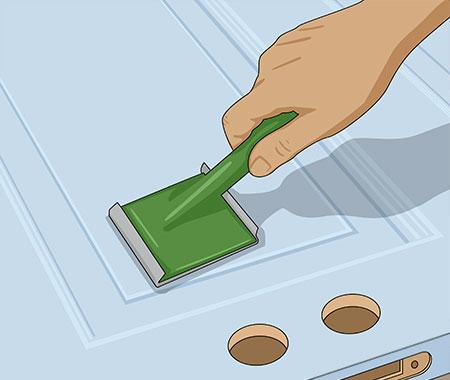 Släta ut färgen med en planstrykare