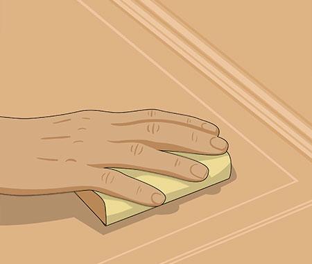 Slipa ytan lätt med ett fint slippapper