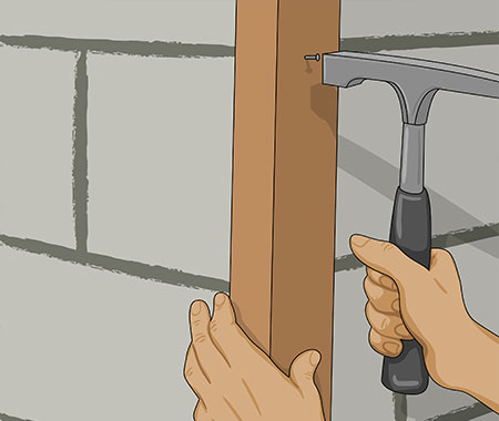Steg 13. I väggens hörn förvattna och spika fast en hörnbräda