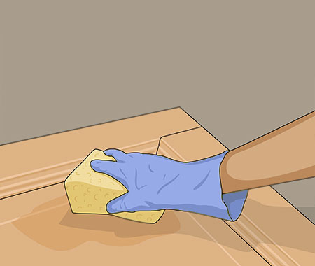 Tvättar dörren med målartvätt när all färg är borta
