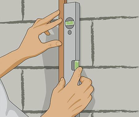 Steg 4. Sätt upp trälister (avjämningslister)på väggen använd vattpass.