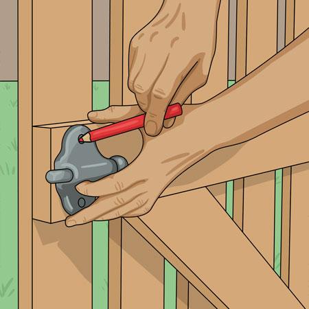 Monterar grindlås på grinden