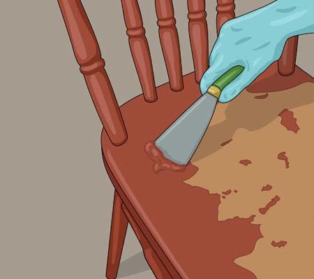 Skrapa försiktigt med en stålspackel
