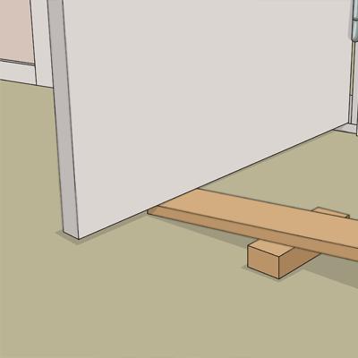 Lägg en stadig bräda under dörren