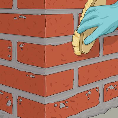 Borsta den murade ytan med en hård borste
