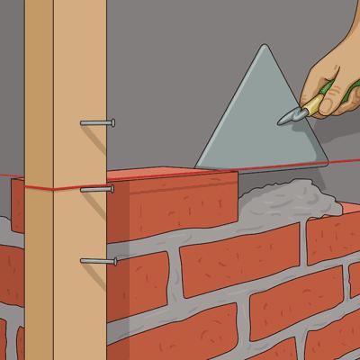 Börjar mura genom att lägga på murbruk