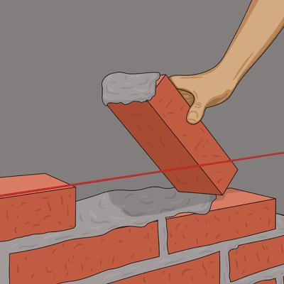 Murar och trycker tegelstenen på plats