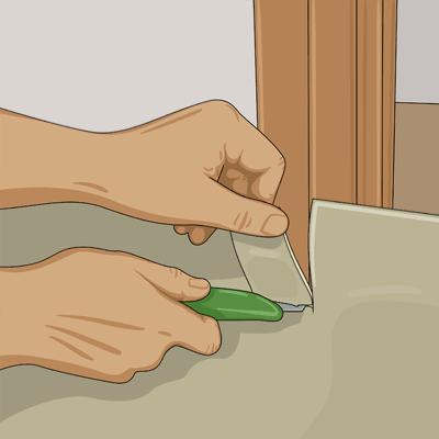 Skär bort mattfliken med den raka mattkniven.